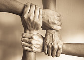 Hands united helping each other.