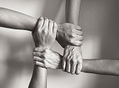 Hands coming together. Black and white image.