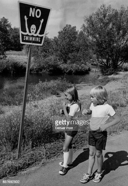 JUL 8 1977 AUG 6 1977 AUG 10 1977 ***** In Wheat Ridge Clear Creek Bobbie Jo Bentley Crosses a bridge near sign and right she and Mark Anderson...