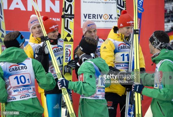 In yellow jackets third placed Michael Neumayer Richard Freitag Andreas Wellinger and Severin Freund of Germany are greeted by runner up Andreas...