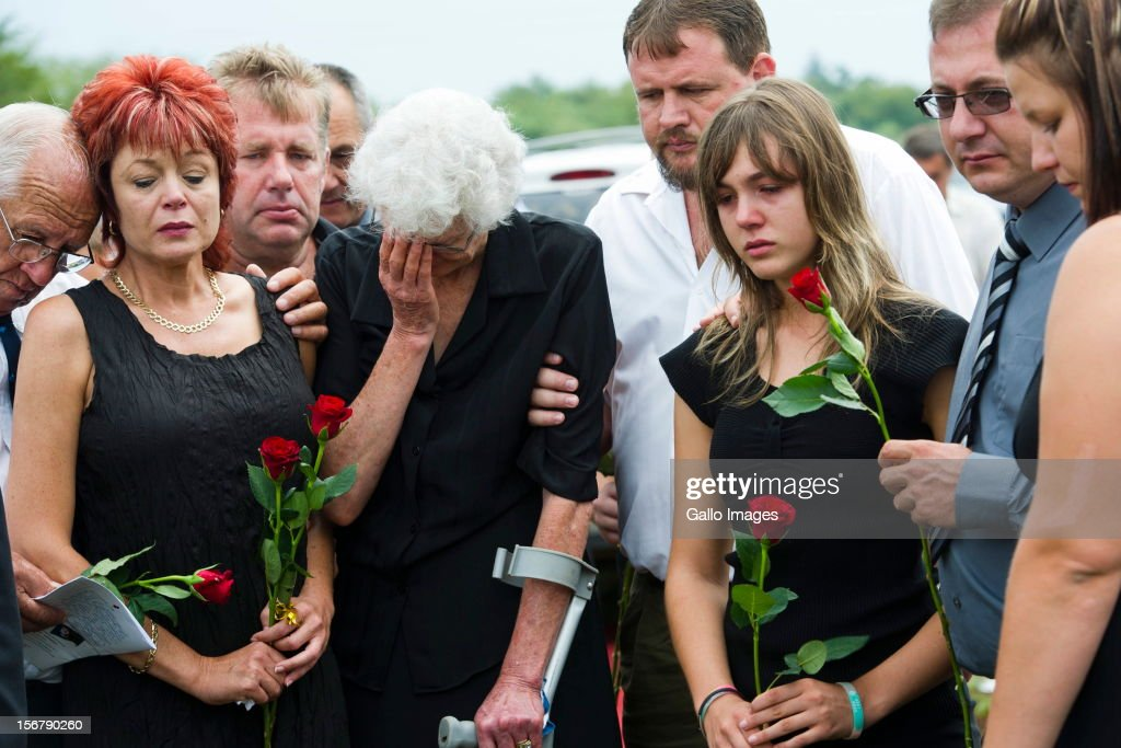 Ina Bonnette, and her family attend Conrad Bonnette's funeral on January 13, 2012 in Bela-Bela, South Africa. Conrad Bonnette (19) was allegedly shot by his stepfather Johan Kotze. Kotze faces 17 charges which include murder, conspiracy to rape, rape, sexual assault, kidnapping and common assault. He is also appearing in court in connection with an attack on his estranged wife, Ina.