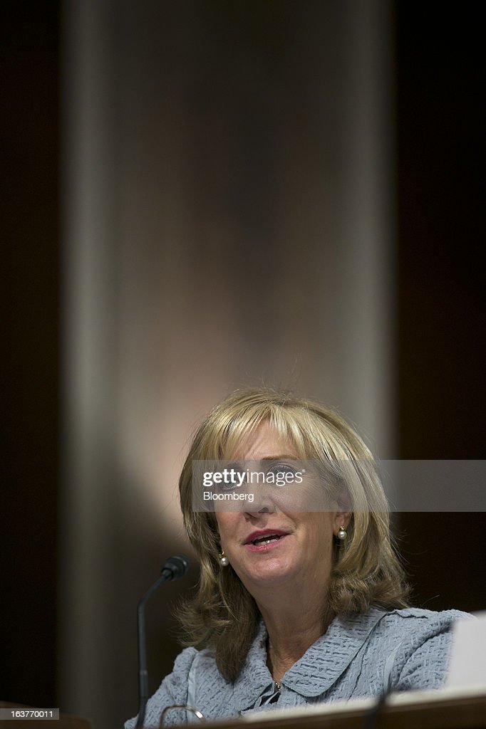 Ina Drew, former chief investment officer with JPMorgan Chase & Co., speaks during a Senate Permanent Subcommittee on Investigations hearing in Washington, D.C., U.S., on Friday, March 15, 2013. JPMorgan Chase, the biggest U.S. bank by assets, compensated chief investment office traders in a way that encouraged risk-taking before the unit amassed losses exceeding $6.2 billion, a Senate committee said. Photographer: Andrew Harrer/Bloomberg via Getty Images