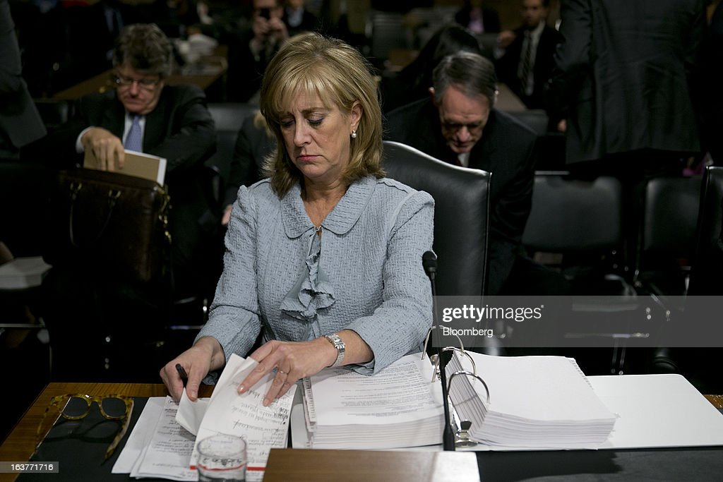 Ina Drew, former chief investment officer with JPMorgan Chase & Co., finishes a Senate Permanent Subcommittee on Investigations hearing in Washington, D.C., U.S., on Friday, March 15, 2013. JPMorgan Chase, the biggest U.S. bank by assets, compensated chief investment office traders in a way that encouraged risk-taking before the unit amassed losses exceeding $6.2 billion, a Senate committee said. Photographer: Andrew Harrer/Bloomberg via Getty Images