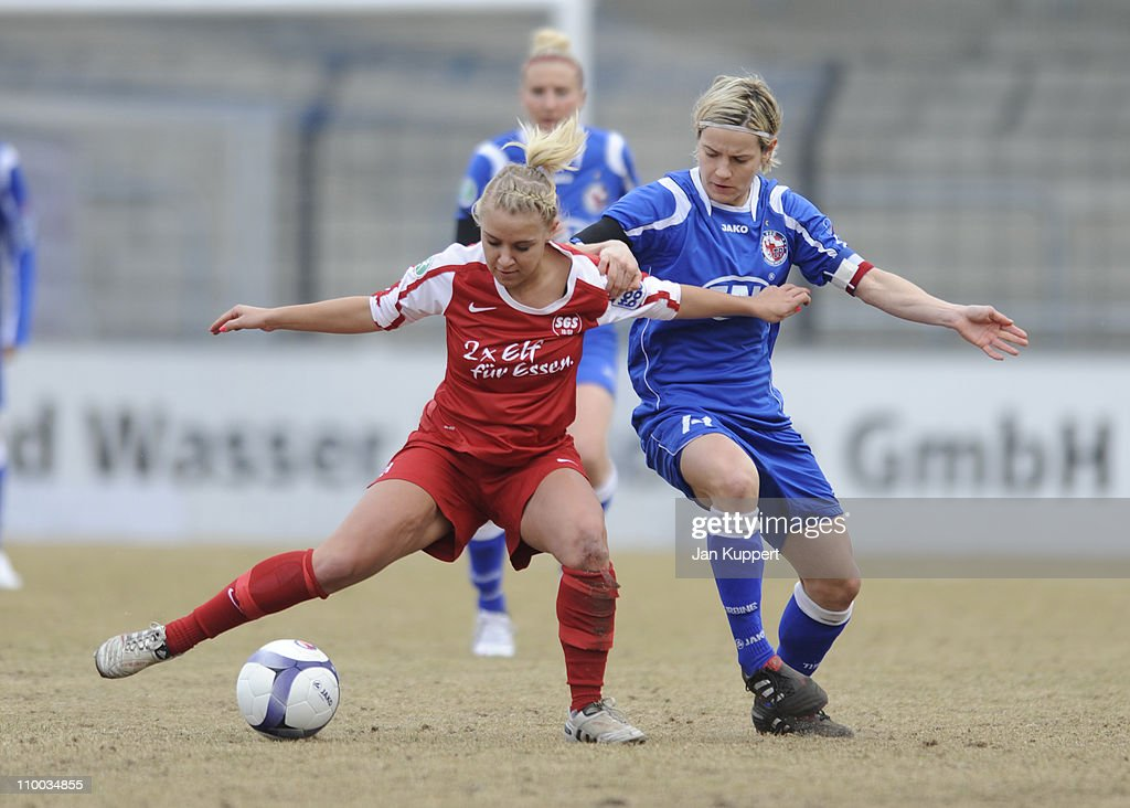 Ina Mester (L) of Essen and Jennifer Zietz (R) of Potsdam battle for the ball during the Women Bundesliga match between Turbine Potsdam and Essen-Schoenebeck at the Karl-Liebknecht stadium on March 13, 2011 in Potsdam, Germany.