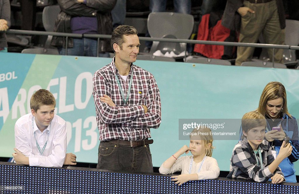 Inaki Urdangarin (2L) and his kids Juan Valentin Urdangarin (L), Irene Urdangarin (3L) and Miguel Urdangarín (4L) attend the Men's Handball World Championship 2013 final match between Spain and Denmark at Palau Sant Jordi on January 27, 2013 in Barcelona, Spain.