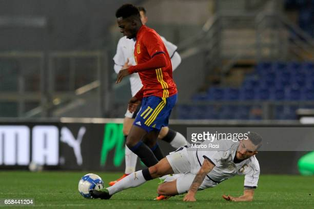 Inaki Williams of Spain U21 compete for the ball with Danilo Cataldi of Italy U21 during the international friendly match between Italy U21 and Spain...
