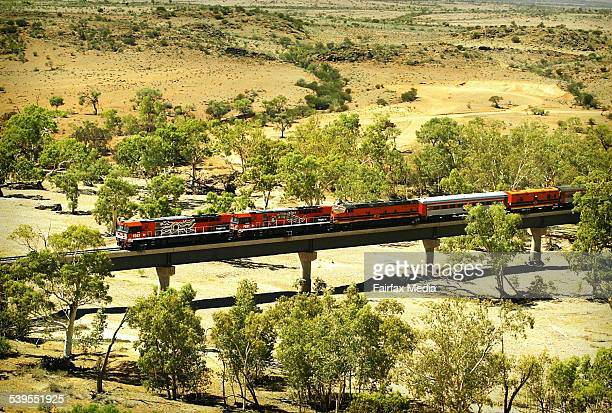 Inaugrial freight train on the Adelaide to Darwin railway line The first of many freight trains is pictured here just outside Alice Springs on its...