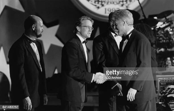 Inaugural ball / Actor Michael Douglas greets Pres Bill Clinton January 17 1999