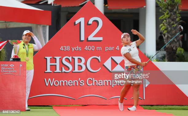 Inbee Park of Korea and Ha Na Jang of Korea are pictured on a red carpet with the trophy during a photocall for HSBC Women's Champions on the Tanjong...