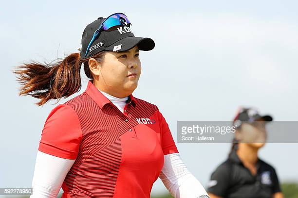 Inbee Park of Korea and Lydia Ko of New Zealand walk on the sixth hole during the Women's Golf Final on Day 15 of the Rio 2016 Olympic Games at the...