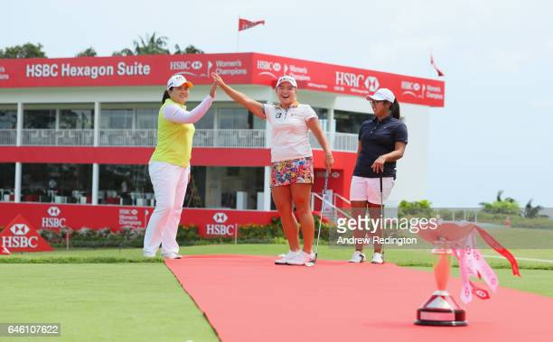 Inbee Park of Korea Ha Na Jang of Korea and Amanda Tan of Singapore are pictured on a red carpet with the trophy during a photocall for HSBC Women's...