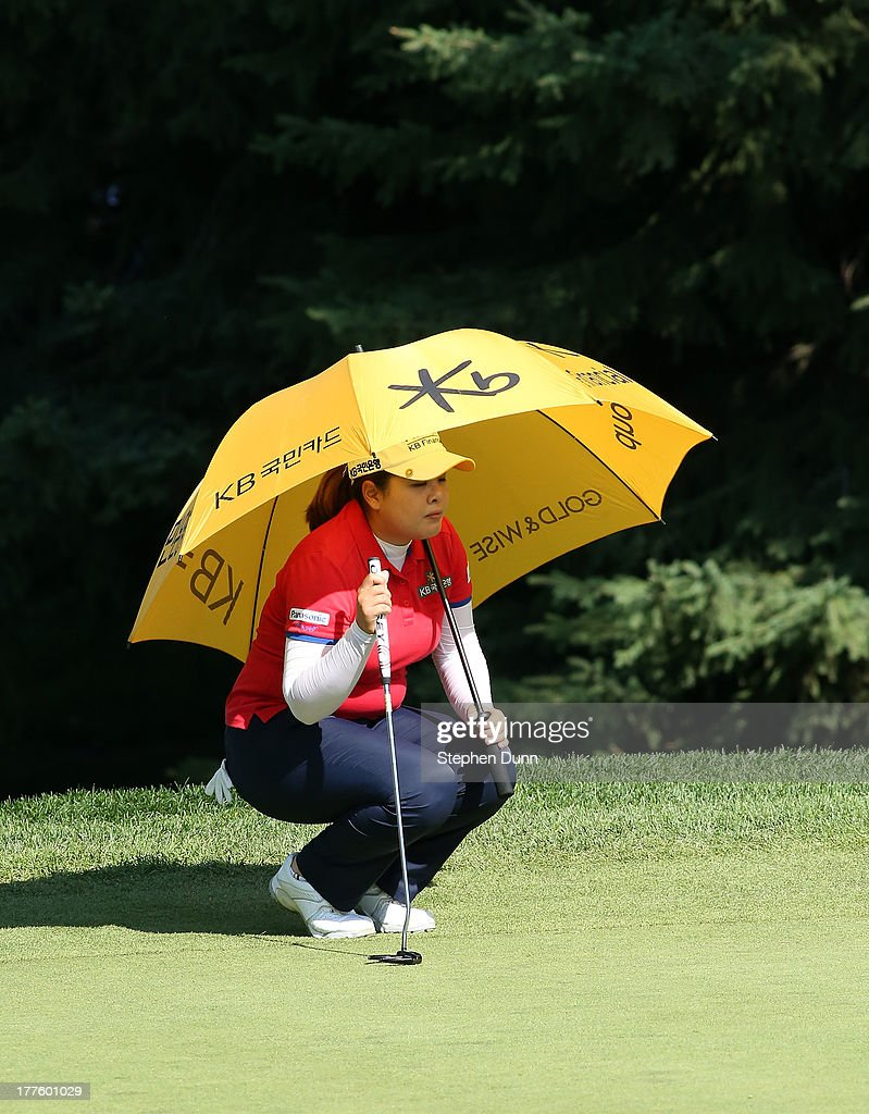 <a gi-track='captionPersonalityLinkClicked' href=/galleries/search?phrase=Inbee+Park&family=editorial&specificpeople=4532692 ng-click='$event.stopPropagation()'>Inbee Park</a> of Sough Korea holds an umbrella for shade as she surveys the green on the wecond hole during the third round of the CN Canadian Women's Open at Royal Mayfair Golf Club on August 24, 2013 in Edmonton, Alberta, Canada.