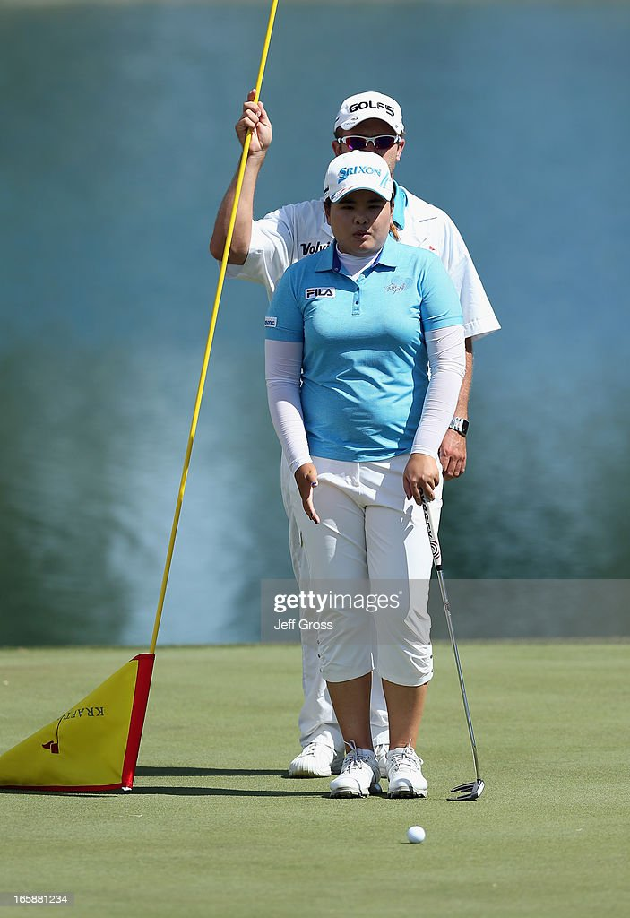 <a gi-track='captionPersonalityLinkClicked' href=/galleries/search?phrase=Inbee+Park&family=editorial&specificpeople=4532692 ng-click='$event.stopPropagation()'>Inbee Park</a> of South Korea and her caddie line up a putt on the sixth green during the third round of the Kraft Nabisco Championship at Mission Hills Country Club on April 6, 2013 in Rancho Mirage, California.