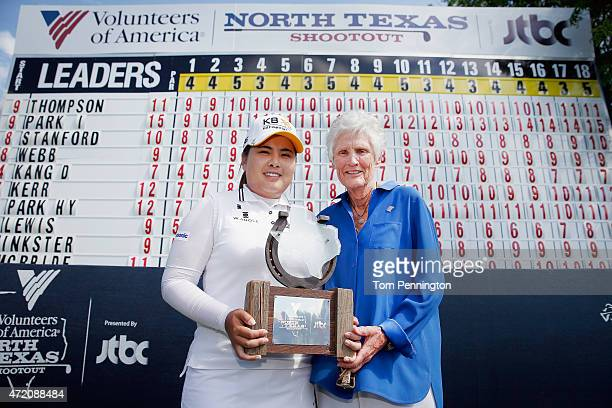 Inbee Park of South Korea and Kathy Whitworth poses with the trophy after Park won the 2015 Volunteers of America North Texas Shootout Presented by...