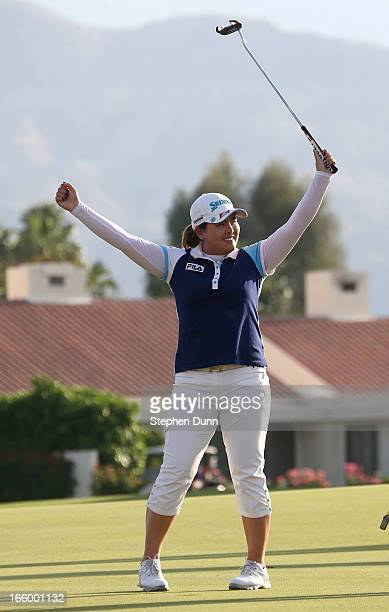 Inbee Park of South Korea celebrates after making the final putt to win the tournament during the final round of the Kraft Nabisco Championship at...