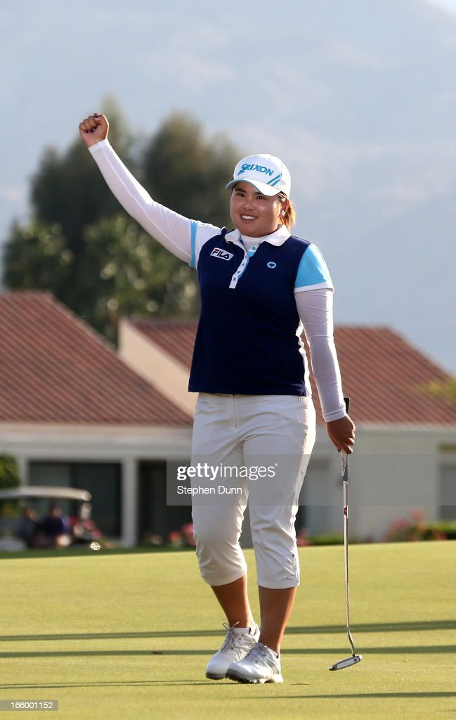 <a gi-track='captionPersonalityLinkClicked' href=/galleries/search?phrase=Inbee+Park&family=editorial&specificpeople=4532692 ng-click='$event.stopPropagation()'>Inbee Park</a> of South Korea celebrates after making the final putt to win the tournament during the final round of the Kraft Nabisco Championship at Mission Hills Country Club on April 7, 2013 in Rancho Mirage, California.