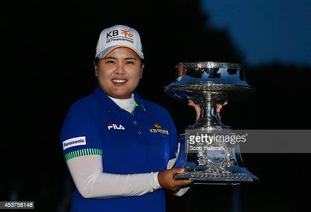 Inbee Park of South Korea celebrates with the trophy after winning the Wegmans LPGA Championship at Monroe Golf Club on August 17 2014 in Pittsford...