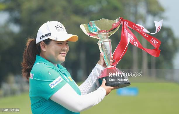Inbee Park of South Korea celebrates with the trophy after winning the HSBC Women's Champions on the Tanjong Course at Sentosa Golf Club on March 5...