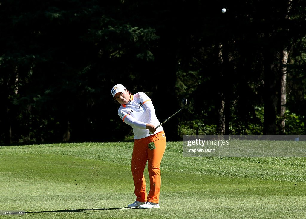 <a gi-track='captionPersonalityLinkClicked' href=/galleries/search?phrase=Inbee+Park&family=editorial&specificpeople=4532692 ng-click='$event.stopPropagation()'>Inbee Park</a> of South Korea hits from the fairway on the 14th hole during the CN Canadian Women's Open at Royal Mayfair Golf Club on August 22, 2013 in Edmonton, Alberta, Canada.