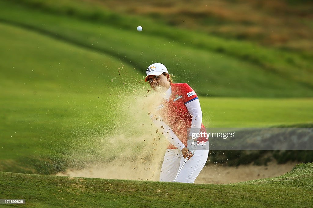 Inbee Park of South Korea hits out of the sand on the eighteenth hole during the third round of the 2013 U.S. Women's Open at Sebonack Golf Club on June 29, 2013 in Southampton, New York.