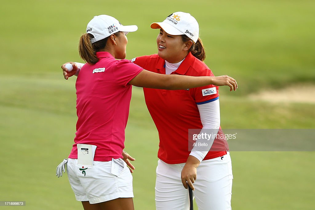 Inbee Park of South Korea hugs I.K. Kim of South Korea after finishing on the eighteenth hole during the third round of the 2013 U.S. Women's Open at Sebonack Golf Club on June 29, 2013 in Southampton, New York.