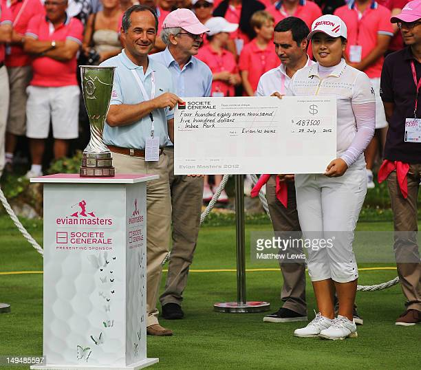 Inbee Park of South Korea is presented with her cheque after winning the Evian Masters at the Evian Masters Golf Club on July 29 2012 in...