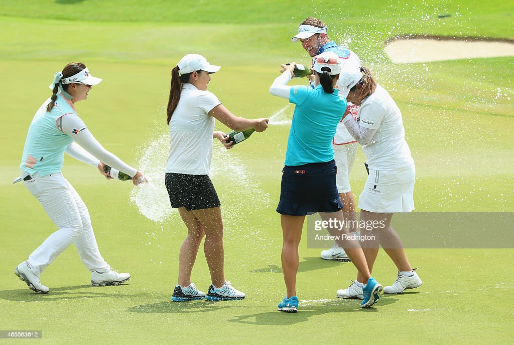 Inbee Park of South Korea is sprayed with champagne on the 18th green after winning during the final round of the HSBC Women's Champions at the...