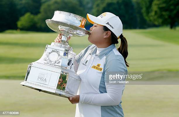Inbee Park of South Korea kisses the trophy after her fivestroke victory at the KPMG Women's PGA Championship on the West Course at the Westchester...