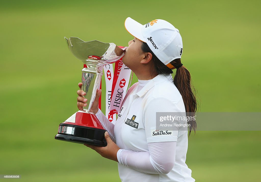 Inbee Park of South Korea kisses the trophy after her victory during the final round of the HSBC Women's Champions at the Sentosa Golf Club on March...
