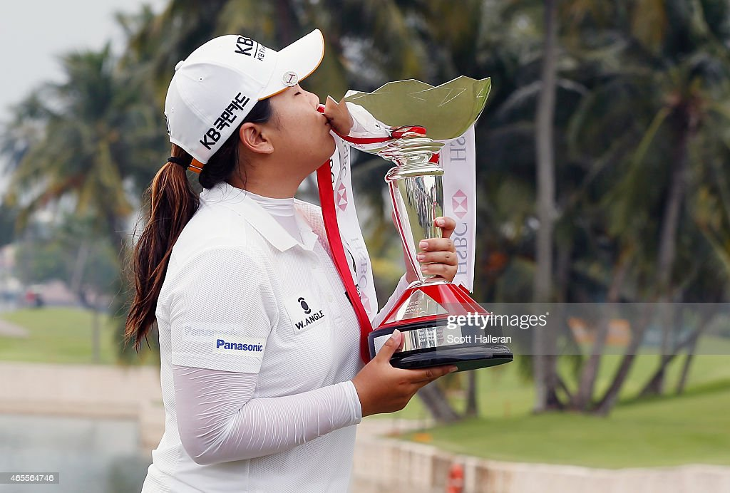 Inbee Park of South Korea kisses the trophy on the 18th green after her twostroke victory at the HSBC Women's Champions at the Sentosa Golf Club on...