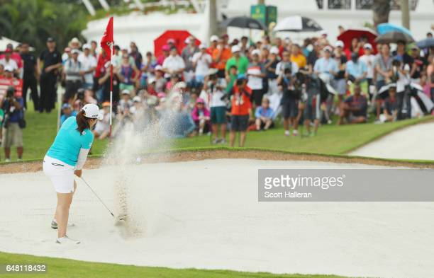 Inbee Park of South Korea plays a bunker shot on the 18th hole during the final round of the HSBC Women's Champions on the Tanjong Course at Sentosa...