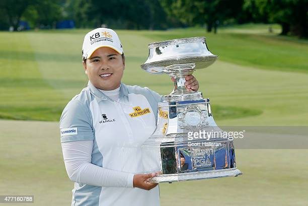 Inbee Park of South Korea poses with the trophy after her fivestroke victory at the KPMG Women's PGA Championship on the West Course at the...