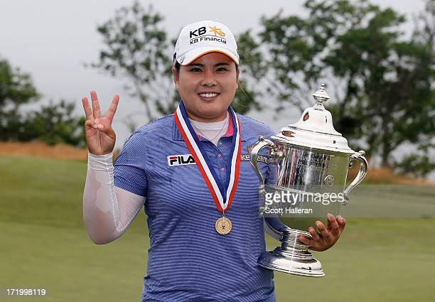 Inbee Park of South Korea poses with the trophy after her fourstroke victory at the 2013 US Women's Open at Sebonack Golf Club on June 30 2013 in...