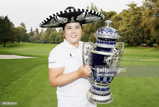 Inbee Park of South Korea poses with the trophy after her threestroke victory at the Lorena Ochoa Invitational Presented By Banamex at the Club de...
