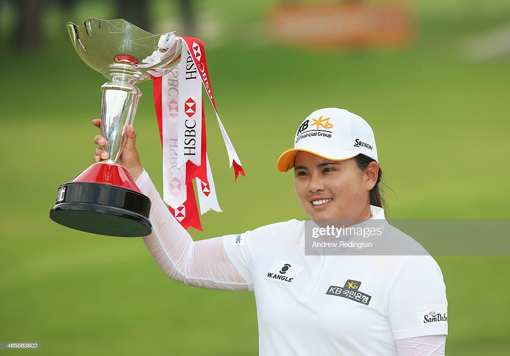 Inbee Park of South Korea poses with the trophy after her victory during the final round of the HSBC Women's Champions at the Sentosa Golf Club on...