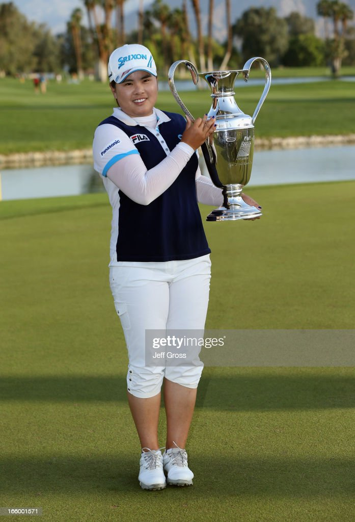 <a gi-track='captionPersonalityLinkClicked' href=/galleries/search?phrase=Inbee+Park&family=editorial&specificpeople=4532692 ng-click='$event.stopPropagation()'>Inbee Park</a> of South Korea poses with the trophy after winning the Kraft Nabisco Championship at Mission Hills Country Club on April 7, 2013 in Rancho Mirage, California.