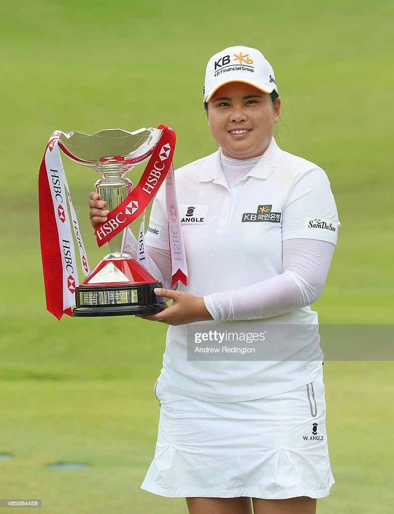 Inbee Park of South Korea poses with the trophy after winning the HSBC Women's Champions at Sentosa Golf Club on March 8 2015 in Singapore Singapore