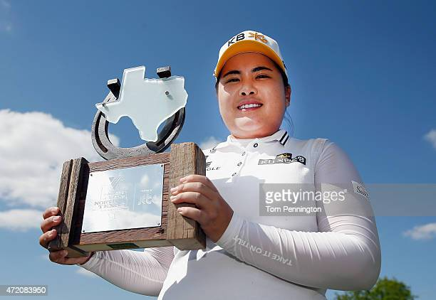 Inbee Park of South Korea poses with the trophy after winning the Final Round of the 2015 Volunteers of America North Texas Shootout Presented by...