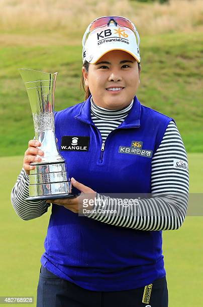 Inbee Park of South Korea poses with the trophy following her victory during the Final Round of the Ricoh Women's British Open at Turnberry Golf Club...