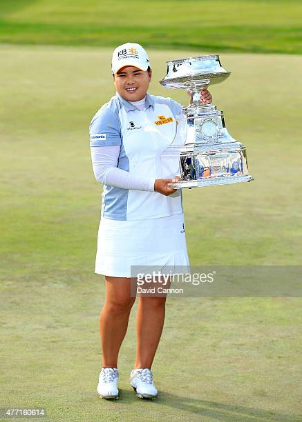 Inbee Park of South Korea proudly holds the trophy after her 5 shot victory in the final round of the 2015 KPMG Women's PGA Championship on the West...