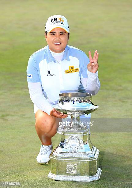 Inbee Park of South Korea proudly holds the trophy and holds three fingers up after she had secured her third win in a row in the final round of the...