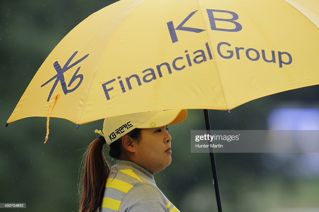 <a gi-track='captionPersonalityLinkClicked' href=/galleries/search?phrase=Inbee+Park&family=editorial&specificpeople=4532692 ng-click='$event.stopPropagation()'>Inbee Park</a> of South Korea stands on the green on the fourth hole during the third round of the Wegmans LPGA Championship at Monroe Golf Club on August 16, 2014 in Pittsford, New York.