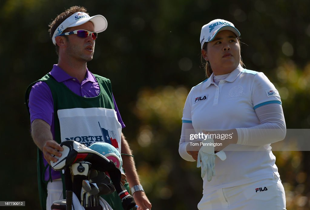 Inbee Park of South Korea talks with her caddie Brad Beecher during the final round of the 2013 North Texas LPGA Shootout at the Las Colinas Counrty Club on April 28, 2013 in Irving, Texas.