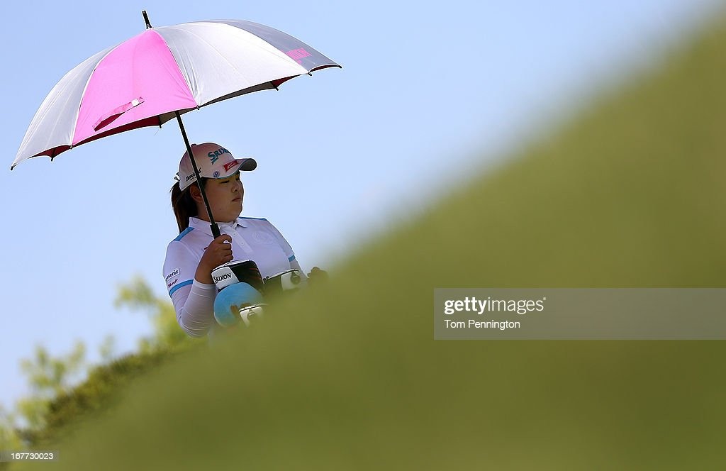 <a gi-track='captionPersonalityLinkClicked' href=/galleries/search?phrase=Inbee+Park&family=editorial&specificpeople=4532692 ng-click='$event.stopPropagation()'>Inbee Park</a> of South Korea waits to hit during the final round of the 2013 North Texas LPGA Shootout at the Las Colinas Counrty Club on April 28, 2013 in Irving, Texas.