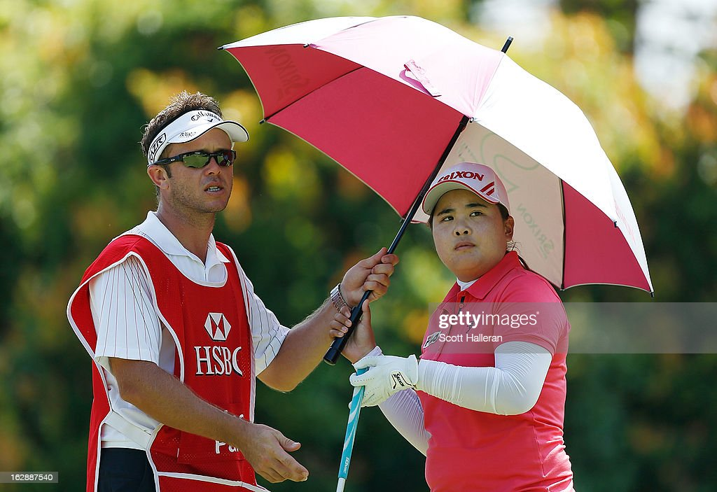 Inbee Park of South Korea waits with her caddie Brad Beecher on the 16th hole during the second round of the HSBC Women's Champions at the Sentosa Golf Club on March 1, 2013 in Singapore, Singapore.