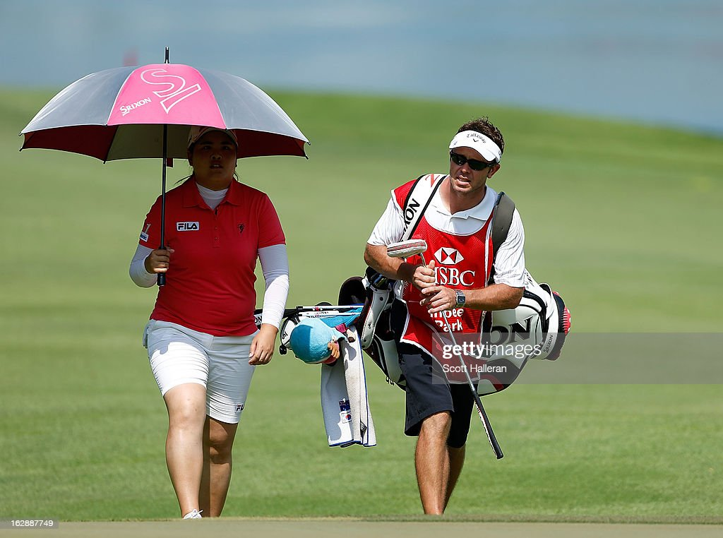 Inbee Park of South Korea walks with her caddie Brad Beecher on the 15th hole during the second round of the HSBC Women's Champions at the Sentosa Golf Club on March 1, 2013 in Singapore, Singapore.