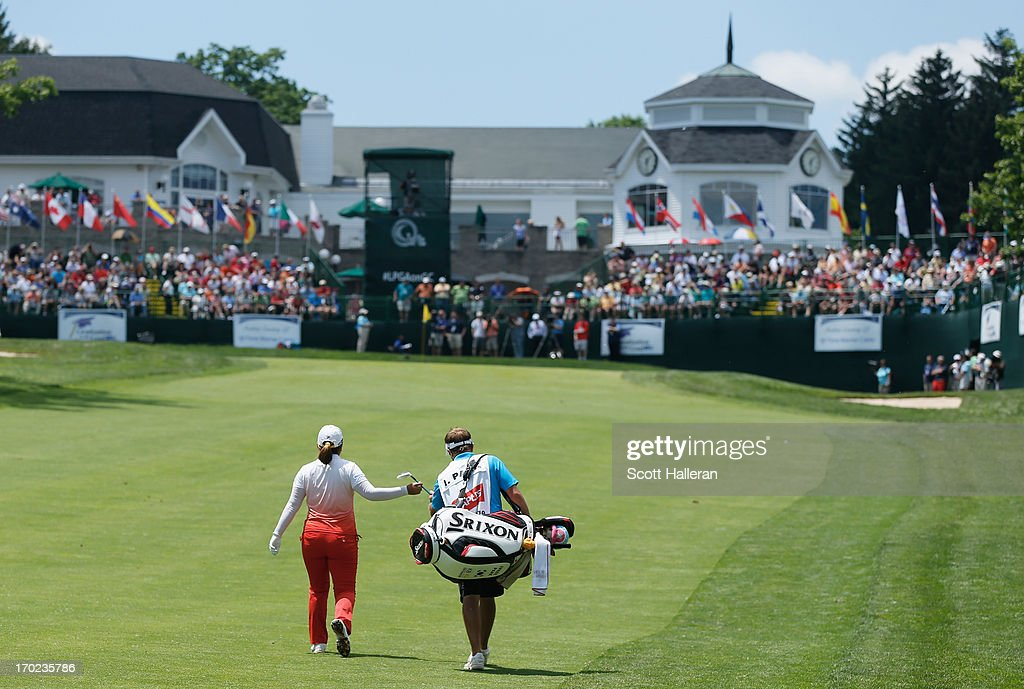 Inbee Park of South Korea walks with her caddie Brad Beecher on the 18th hole during the weatherdelayed third round of the Wegmans LPGA Championship...
