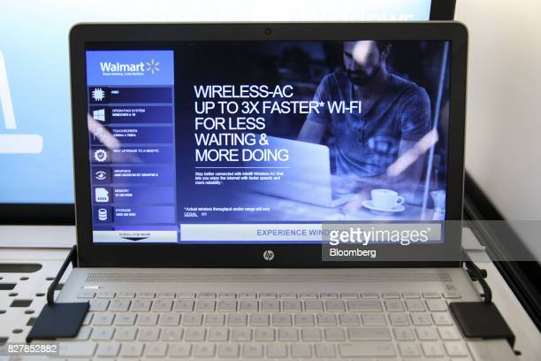 Inc laptop is displayed for sale at a WalMart Stores Inc location in Burbank California US on Tuesday Aug 8 2017 WalMart Stores is scheduled to...