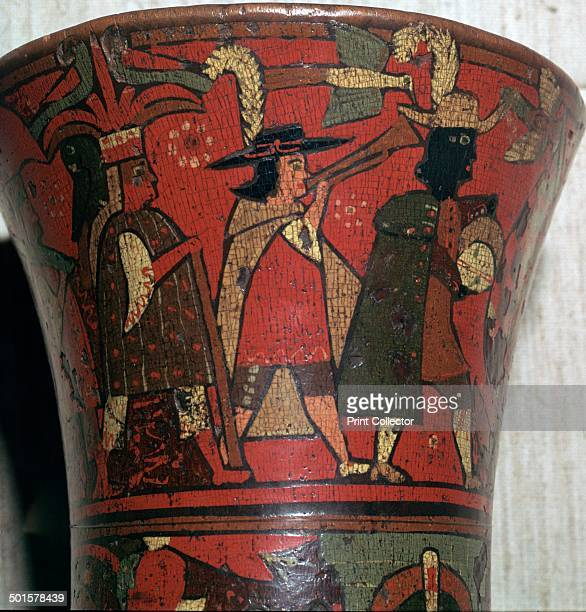 Incan beaker showing Spaniards and Peruvians made of polychrome lacquer with an incised outline on wood Peru probably 17th century From the British...