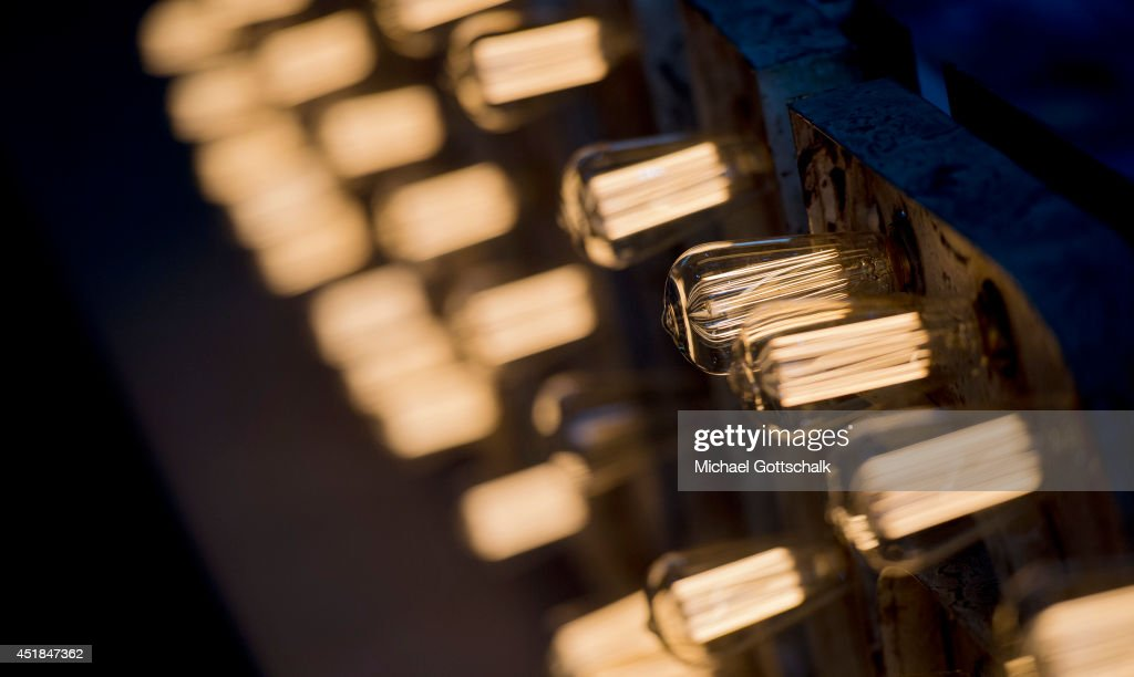 Incandescant bulbs with filaments glow at the booth of an exhibitor at the Bread and Butter trade show at the former Tempelhof airport on July 08, 2014 in Berlin, Germany.